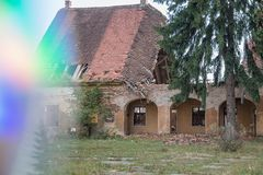 Building falling apart with rainbow royalty free stock photography