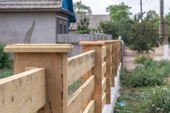 Building a fence in the style of a ranch. Wooden fence details. Wooden fence details. Building a fence in the style of a ranch stock images