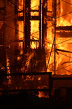 Building on fire. A condo building on fire stock photos
