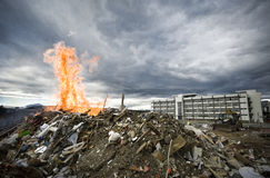 Building and fire. Dump on fire with building behind Stock Photos