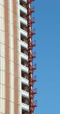 Building with an fire-escape. High-rise building with an external fire-escape Royalty Free Stock Photos