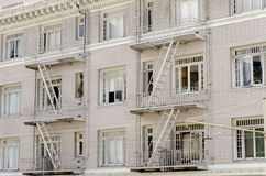 Building with fire escapes Stock Images