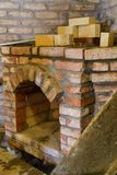Building a fireplace in a house using old bricks. Beautiful bricklaying stock images