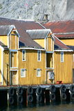 Building on fishing dock. Details of yellow houses and buildings on a fishing dock at Nussfjord, Lofoten Islands, Norway Royalty Free Stock Images