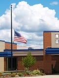 Building with flag half mast Stock Photos