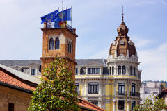Building with flags 1. Buildings in a typical Asturian town with sunlight and flags Stock Photos