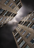 Building Flats. Flats against a dark stormy sky stock photos