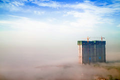 Building in fog Royalty Free Stock Image