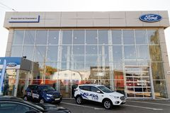 Building of Ford car selling and service center with Ford sign. Ulyanovsk, Russia - September 23, 2018: Building of Ford car selling and service center with stock photo