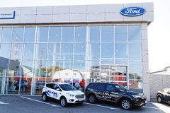 Building of Ford car selling and service center with Ford sign. Ulyanovsk, Russia - September 23, 2018: Building of Ford car selling and service center with stock image