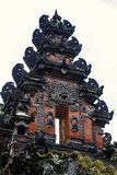 Building fragment in authentic style. Ancient architecture of Indonesia. Sights of Bali royalty free stock photo