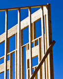 Building frame. Wooden frame for building structure up against blue sky Royalty Free Stock Photography