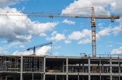 Building framework and tower cranes Stock Photos