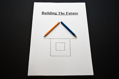 Building the future. Planning for business; Building the Future; white paper, pencils, drawing of a house Stock Photography