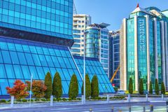 Building generali. SERBIA, BELGRADE - SEPTEMBER 30: Modern glass structure of Generali Insurance building and part of the Crowne Plaza hotel building on Royalty Free Stock Photography