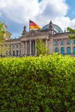 The building of the German Parliament the Reichstag and the flag Stock Photography