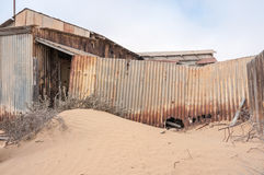 Building at the ghost town of Kolmanskop Royalty Free Stock Image