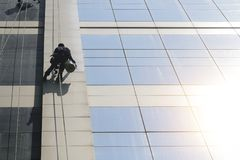 The building glass cleaner man cleaning the window of business b stock photography