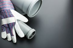 Building glove and soil-pipe on grey Stock Images