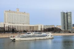 Building of the government of the Russian Federation, Building of Moscow governmet and pleasure boat on the Moscow river. Stock Images