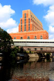 Building on the Grand River. The Grand River and the Accident Fund building in Lansing, Michigan stock photo