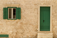 Building with green door Royalty Free Stock Photo