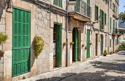 Building with green doors and shutters Stock Images