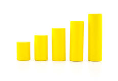 Building a growing financial graph using yellow color wood toy. Building a growing financial graph using yellow color wood toy isolated on white background Stock Photos