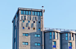 Building with gsm antennas. Industrial building with gsm antennas Royalty Free Stock Images