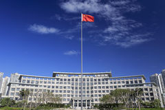 Building of haicang district government. Haicang district government building behind the chinese star red flag, amoy  city, china Stock Photo
