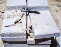 Building hammer, pile of limestone slabs Stock Photo
