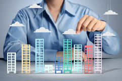 Building in hand businessmen Royalty Free Stock Photo
