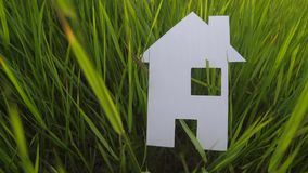 Building happy family construction house concept. paper house stands in lifestyle the green grass in nature. symbol life stock footage
