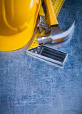 Building helmet claw hammer try square and Stock Photo