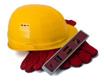 Building helmet, gloves and level Royalty Free Stock Photo