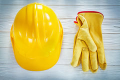 Building helmet leather protective gloves on white board Stock Images