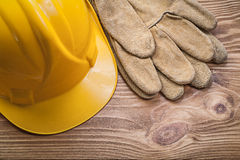 Building helmet leather protective gloves on wooden board constr Stock Photography