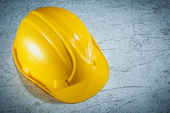 Building helmet on metallic surface construction concept Stock Image