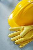 Building helmet protective gloves on concrete surface constructi Stock Photos