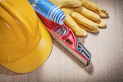 Building helmet protective gloves construction level blue rolled Royalty Free Stock Photography