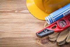 Building helmet protective gloves construction level blueprint o Royalty Free Stock Image