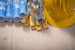 Building helmet protective gloves glasses rolled engineering dra Royalty Free Stock Photography
