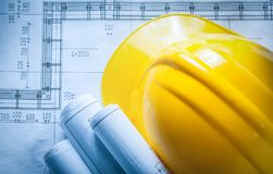 Free Building Helmet Rolled Construction Plans On Blueprint Stock Photos - 107057083
