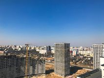 Building with the help of construction cranes of high reinforced concrete, panel, cast-frame, frame-block houses, buildings royalty free stock photos