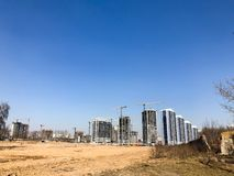 Building with the help of construction cranes of high reinforced concrete, panel, cast-frame, frame-block houses, buildings stock image