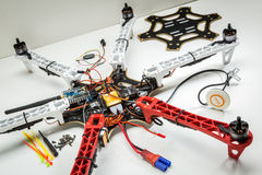 Building a hexacopter drone. FORT COLLINS, CO, USA, JULY 20, 2015: Assembling a hexacopter drone (DJI F550 Flame Wheel). all parts are in place except video stock photography