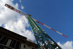 Building high. A tower crane used for a rising building Stock Image