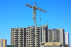 Building high-rise prefabricated house. Prefabricated house and construction site with tower crane Stock Image