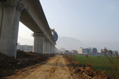 A building high-speed rail through a village of China Stock Photography
