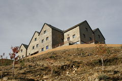 Building on hilltop. Multistory building on the top of a hill Stock Photo